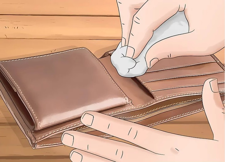 Use a dry, soft and absorbent towel from inside to outside the wallet