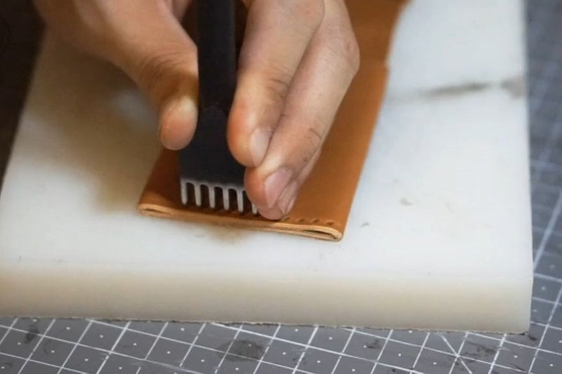 Use saddle stitch on the edge of the wallet