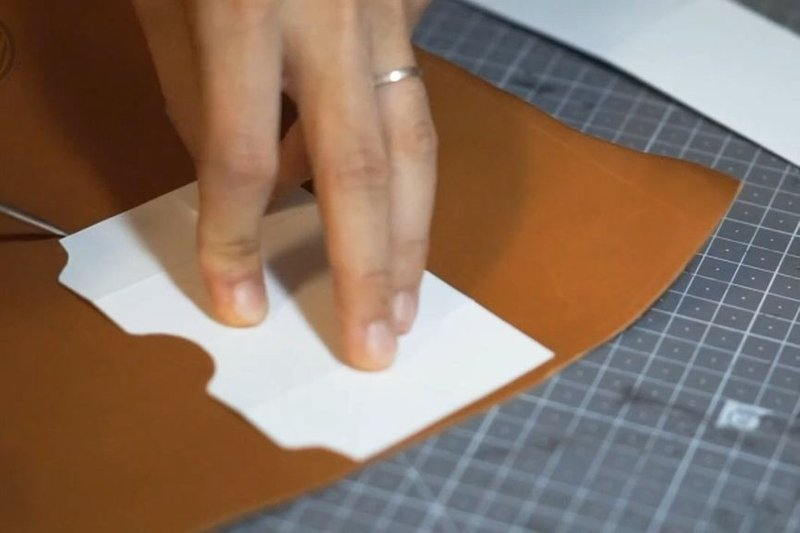 Cutting the leather following pattern