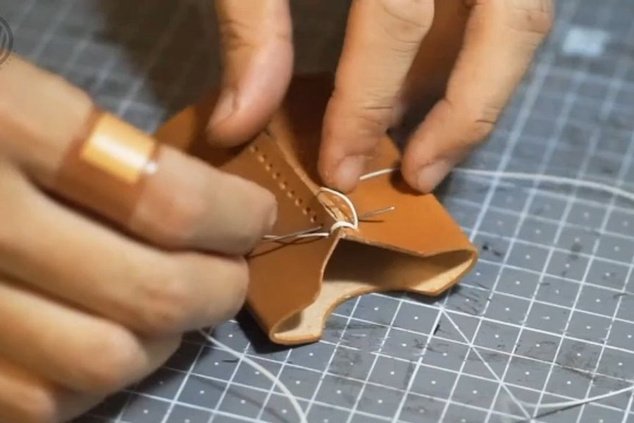 Use cross-stitching on the two pocket parts
