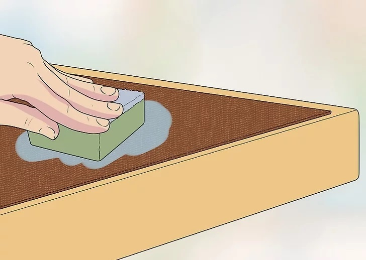 Begin the embossing process by using a damp sponge to moisten the leather