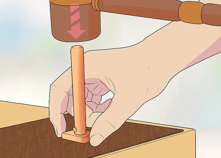 use the mallet to pound the other end of the cylinder
